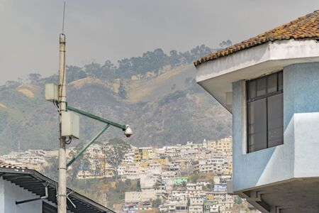 low  angle: Low angle shot house detail and mountains with houses at background in the historic of Quito, Ecuador