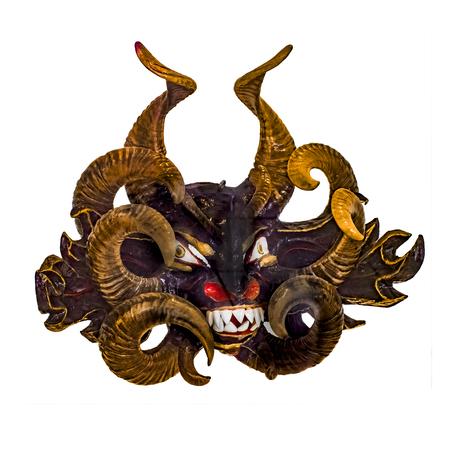 hellish: Tribal wood mask with diabolic expression isolated in white background