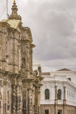 low angle views: Low angle view of baroque and neoclassical style buildings at the historic center of Quito in Ecuador.