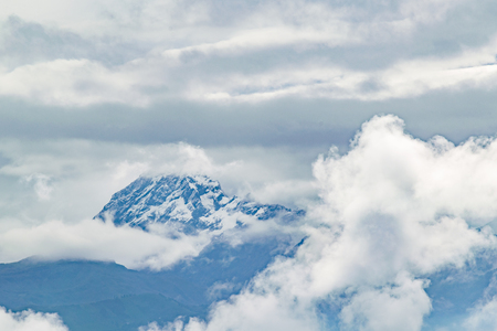 highs: Landscape scene view of chimborazo volcano from the highs of building in Riobamba, Ecuador, South America Stock Photo