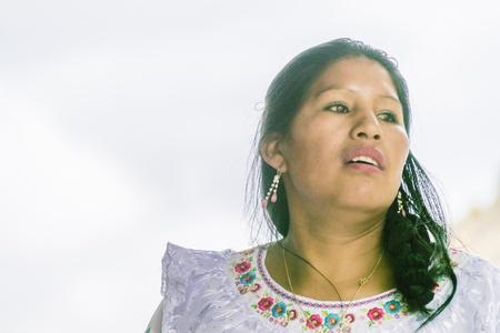 ecuadorian: ALAUSI, ECUADOR, OCTOBER - 2015 - Native ecuadorian indigenous woman dressing traditional clothing dance at nariz del diablo trip in Alausi, Ecuador