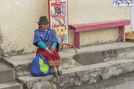 indigenous: ALAUSI, ECUADOR, OCTOBER - 2015 - Native ecuadorian indigenous woman dressing traditional clothes in Alausi, Ecuador