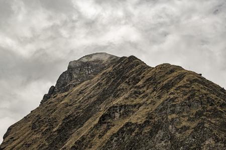 wheater: Low angle view of Nariz del Diablo, a touristic attraction rocky mountain in Alausi, Ecuador Stock Photo