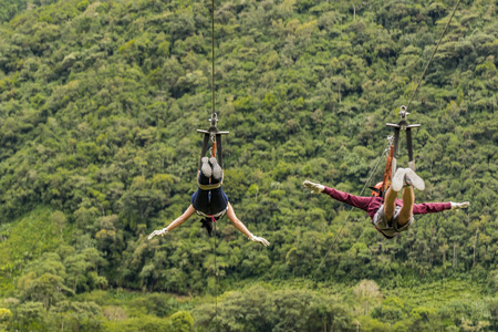 highs: People making canopy, and extreme touristic activity hanged on wire at highs in Banos, Ecuador Stock Photo