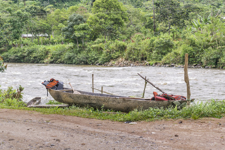 amazonia: Indigenous wooden boat parked at riverfront in ecuadorian amazonia, Puyo, Ecuador.