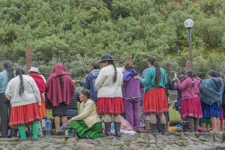 cuenca: CUENCA, ECUADOR, OCTOBER - 2015 - Group of native ecuadorian catholic indigenous praying at outdoors in Cuenca outskirts, Ecuador, South America