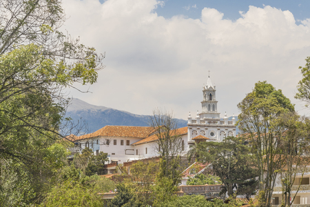eclecticism: Low angle view of elegant old style eclectic buildings at Cuenca, Ecuador. Stock Photo
