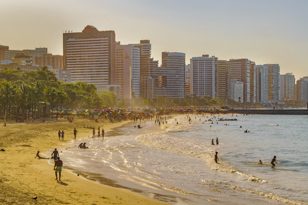Cityscape scene depicting the coastline beach surrounded by modern modern buildings in Fortaleza, Brazil