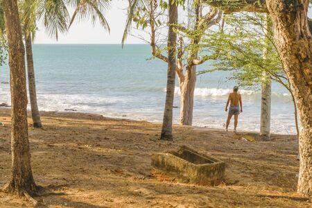 Man watching the sea at park coastline in Fortaleza, Brazil
