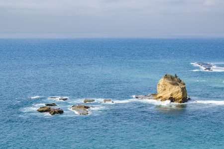Aerial view of big rock in the middle of sea in Puerto Lopez town, Ecuador, South America Stock Photo