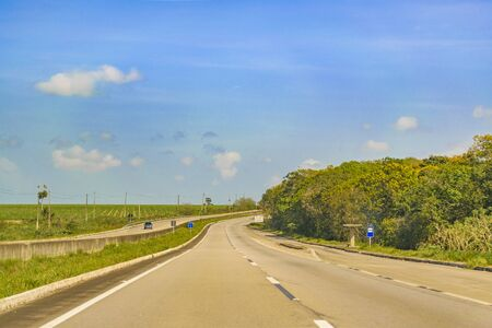PARAIBA, BRAZIL, JANUARY - 2016 - Sunny day at wodded highway in Paraiba district at north of Brazil. Stock Photo