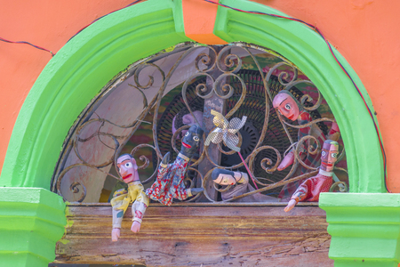 Close up view of a bunch of puppets at top of door