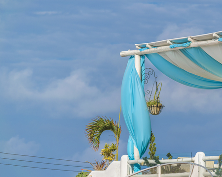 Low angle shot of roof with textile cover against blue sky Stock Photo