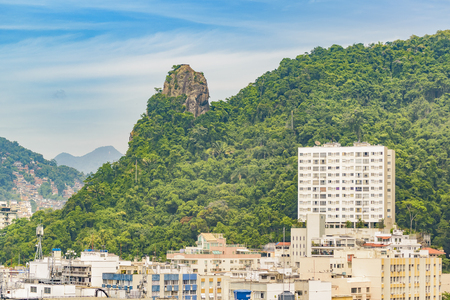 janeiro: Modern buildings and leafy mountain at background in Rio de Janeiro, Brazil