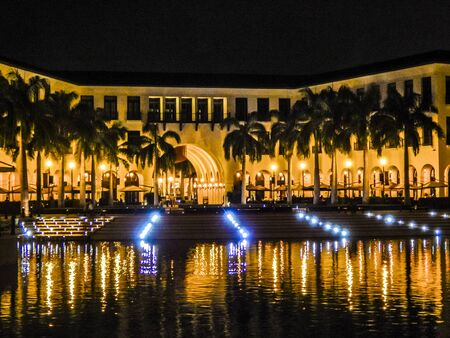 Night scene in Plaza Lagos, a luxury location with restaurants and artificial lake located in Samborondon city, Ecuador Editorial
