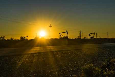 Sunset scene from road with oil machine at outdoor in argentinian patagonia, Santa Cruz province