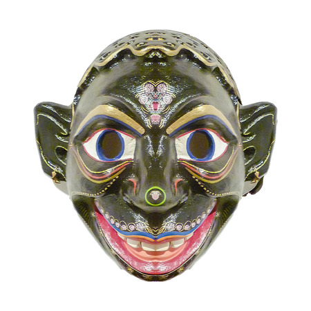 Ecuadorian indian tribal wood mask with funny expression isolated in white background