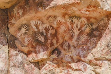 Detail view of primitive art painted on rock at Cueva de las Manos, an archeological site located in the patagonia, Argentina.