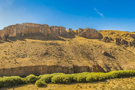 Patagonia landscape scene with big rocky mountains as main subject in Santa Cruz province, Argentina