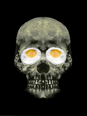 scaring: Funny digital photo collage artwork showing a portrait head skull with fried egg eyes Stock Photo