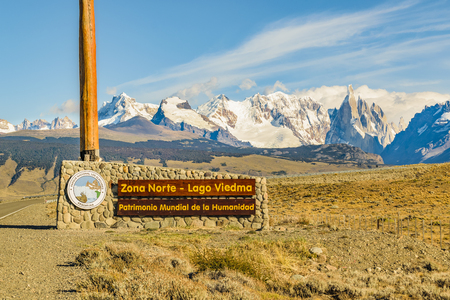 Signpost wich translate Viedma Lake, World Heritage with patagonian andes range landscape mountain at background at El Chalten town, Argentina Stock Photo