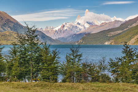 Argentinian patagonian landscape scene with lake and snowy mountains as main subject