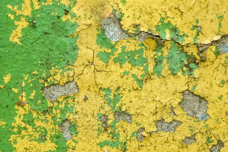 Abstract cracked grunge texture in yellow and green colors