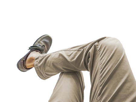 Isolated body part man leg with trouser and shoes without socks against white background