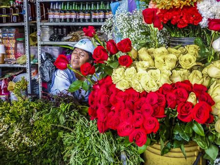 GUAYAQUIL, ECUADOR, DECEMBER - 2016 - Flowers and vendor at flower shop in Guayaquil, Ecuador