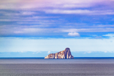 cristobal: Distant view of famous leon dormido rock at middle of pacific ocean near Galapagos Islands, Ecuador Stock Photo