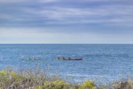People practicing canoeing at ocean in Galapagos island, Ecuador