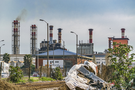 MONTEVIDEO, URUGUAY, AUGUST - 2016 - Urban scene with neglected environment and industrial buildings at background