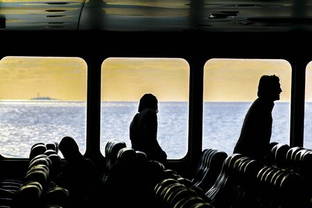 Interior scene with people leaving the ferry at Colonia city, Uruguay