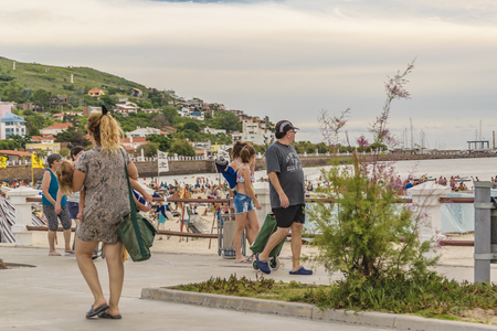 PIRIAPOLIS, URUGUAY, FEBRUARY - 2016 - Crowded waterfront boardwalk at Piriapolis city, Uruguay Editorial