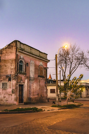 Urban night scene with abandoned two floor house as main subject Editorial