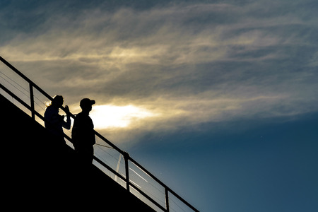 High contrast silhouette scene of couple at viewpoint