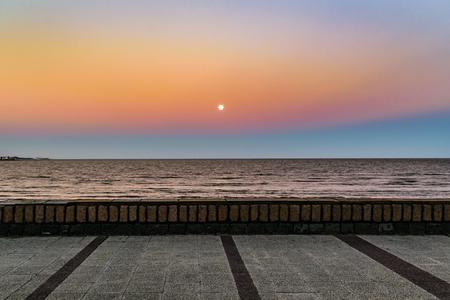 Sunset scene at watefront boardwalk in pocitos beach, Montevideo, Uruguay