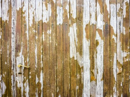 Abstract wooden grunge door texture background in brown and white colors