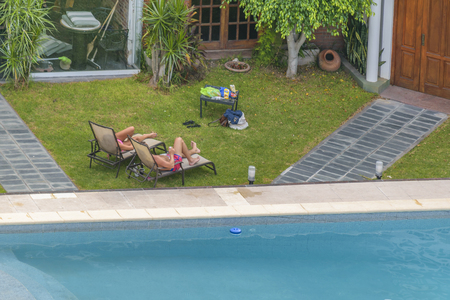 SANTA FE, ARGENTINA, JANUARY - 2017 - High angle long distant view at home garden with swimming pool
