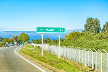 Puerto montt sign at highway at chilean patagonia territory