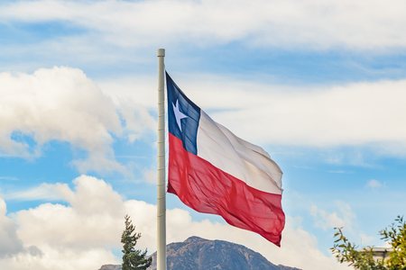 Chile flag flaming at coyhaique square, Aysen district. Stock Photo