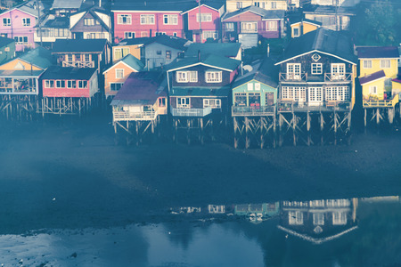 High angle shot of typical palafito houses at lake in Castro city, Chiloe Island, Chile