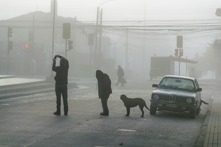Foggy urban morning scene at chiloe island, chile