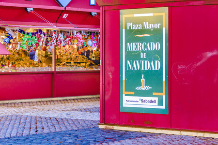 MADRID, SPAIN, DECEMBER - 2017 - Placard of christmas market with spanish text christmas market at plaza mayor, Madrid, Spain