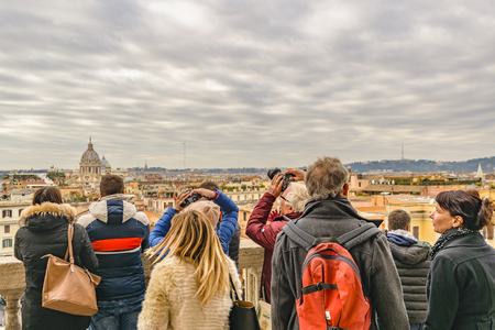 ROME, ITALY, DECEMBER - 2017 - Tourist watching the view at top of piazza di spagna, the most famous plaza of Rome.