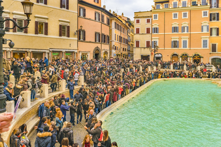 ROME, ITALY, JANUARY - 2018 - Crowded urban scene at fontana di trevi, the most famous fountain of Rome city, Italy Editorial