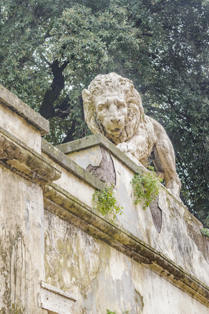 Low angle view of lyon sculpture at villa borghese park, Rome, Italy