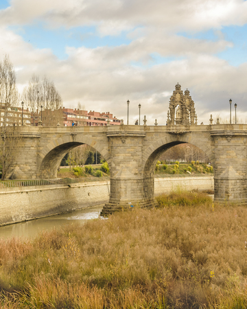 MADRID, SPAIN, DECEMBER - 2017 - Segovia bridge, a renaissance fourteenth century style construction located at manzanares district in Madrid, Spain