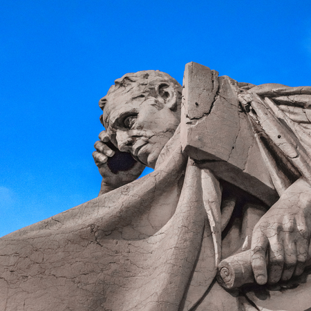Low angle view thinker man statue against blue sky background Foto de archivo