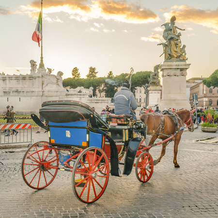 ROME, ITALY, JANUARY - 2018 - Touristic carriage crossing street at piazza venezia, Rome, Italy